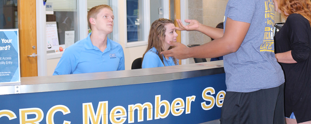 students working at member services desk