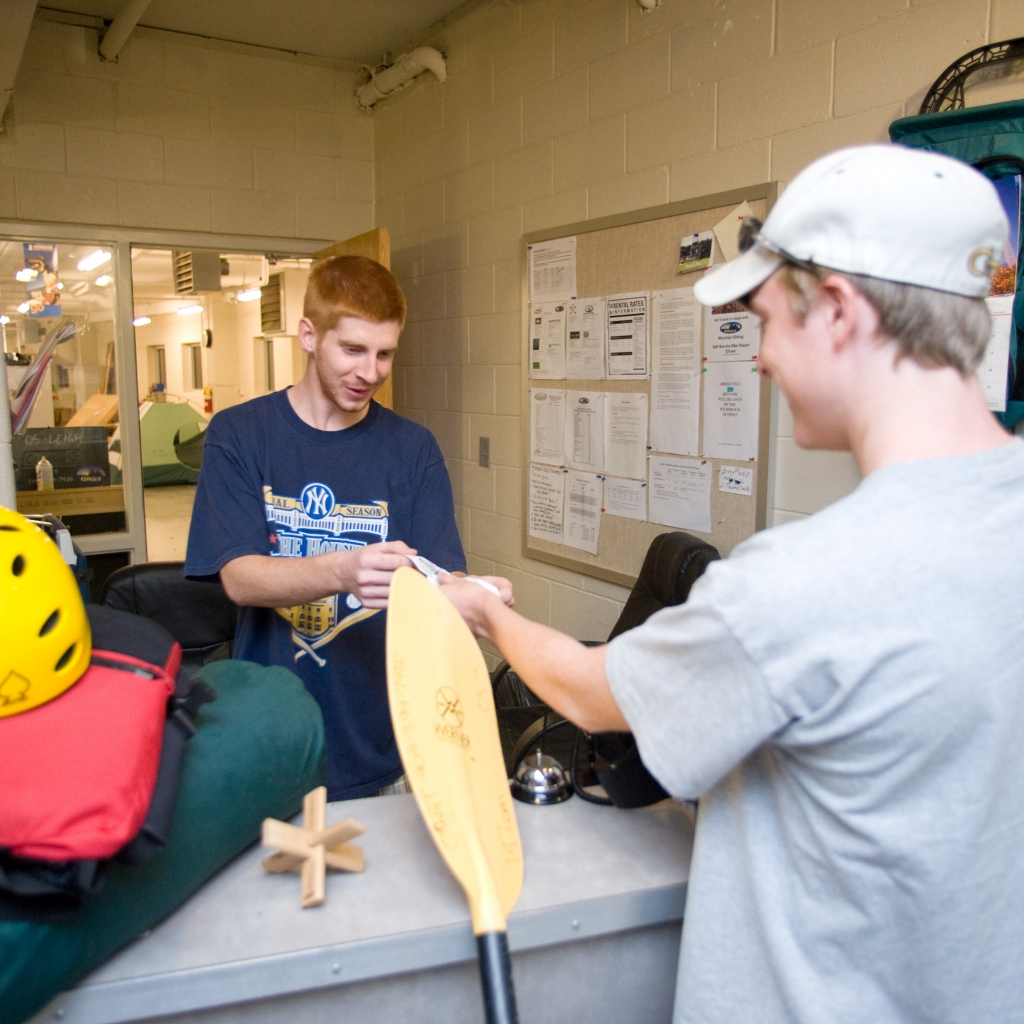 Student renting equipment at the Wilderness Outpost